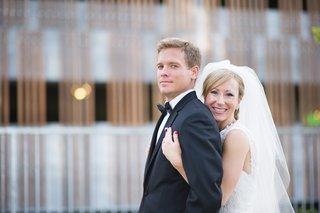 bride-holding-groom-portrait