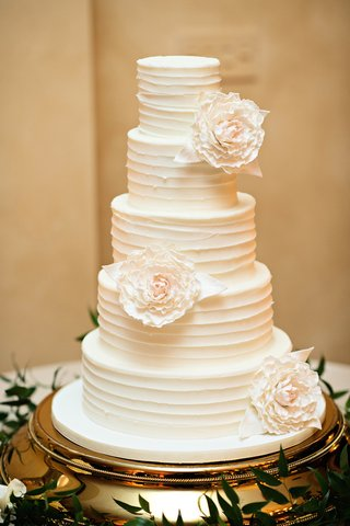 white-wedding-cake-with-textured-frosting-and-white-sugar-peonies