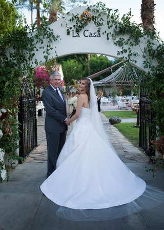 bride-in-oscar-de-la-renta-a-line-wedding-dress-holding-father-of-brides-hand-before-walking-down