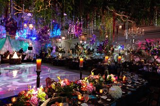 crystal-strands-and-greenery-suspended-from-ceiling-in-enchanted-forest-themed-wedding