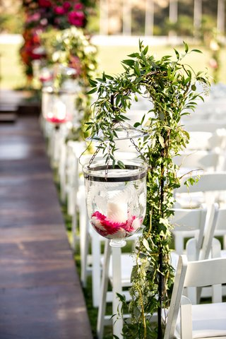wedding-ceremony-aisle-etched-glass-candle-holder-on-shepherd-hook-pink-flower-candles-greenery