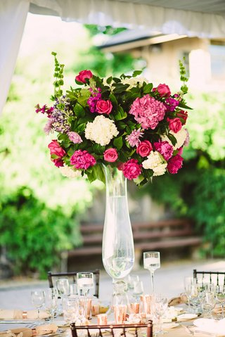 tall-wedding-reception-centerpiece-pink-flowers-rose-hydrangea-peony-green-leaves-rose-gold-candles