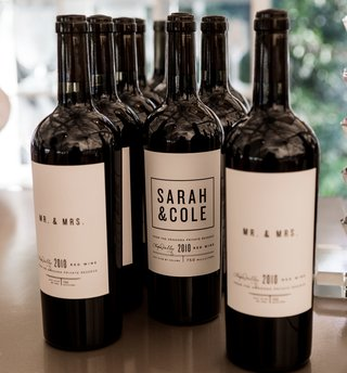 wine-bottles-labeled-with-personalized-label-for-newlyweds