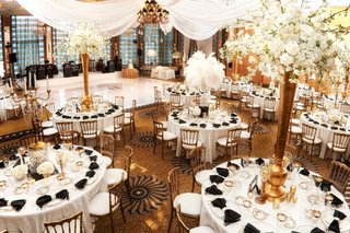 white-tables-gold-chairs-centerpieces-black-napkins-drapery-dance-floor-chicago