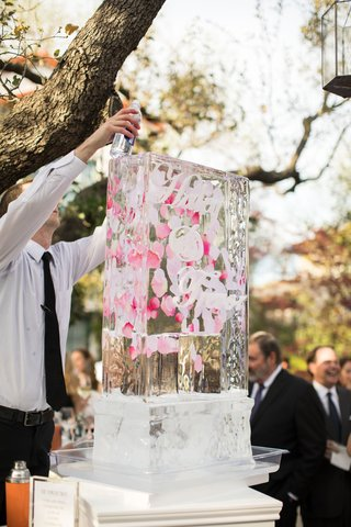 wedding-cocktail-hour-ice-luge-custom-design-couples-names-pink-flower-petals-signature-cocktail