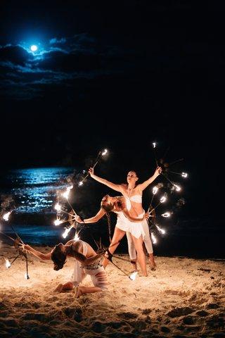 female-fire-dancers-at-a-night-beach-wedding-reception-playa-del-carme-mexico