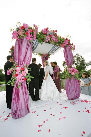 jewish-bride-and-groom-under-vibrant-chuppah