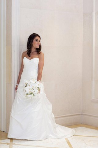bride-in-a-strapless-a-line-romona-keveza-gown-and-white-bouquet