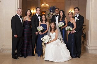 bride-in-a-strapless-romona-keveza-gown-veil-and-white-bouquet-with-loved-ones