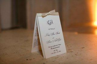 white-wedding-invitation-with-a-cream-ribbon