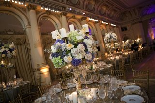 wedding-reception-centerpiece-candelabra-with-blue-green-white-and-blush-flowers