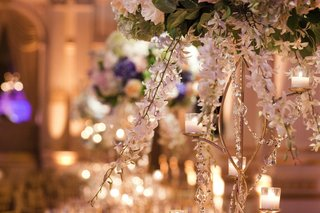 wedding-centerpiece-with-white-orchid-stems-candles-and-crystal-stands
