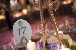 wedding-reception-table-number-with-the-plaza-logo