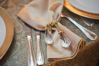 golden-napkin-tied-with-a-golden-rope-with-crystal-ends