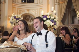 bride-with-groom-in-a-white-shirt-and-black-bow-tie-and-suspenders
