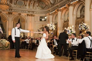 bride-in-an-a-line-romona-keveza-gown-dances-with-groom