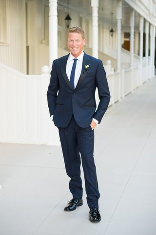 groom-smiling-navy-blue-suit-blonde-groom-hotel-del-coronado-wedding-outdoors-summer-outfit
