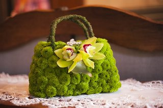 purse-made-of-green-button-mums-and-orchids