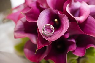 wedding-rings-on-purple-calla-lily-bouquet