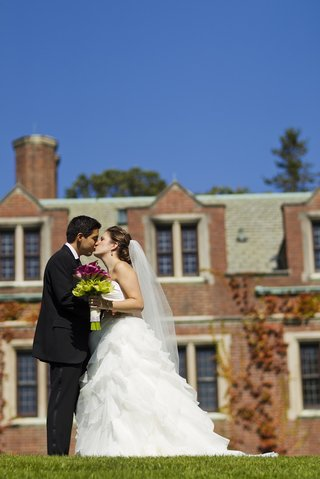bride-and-groom-kiss-in-front-of-the-mansion-at-natirar