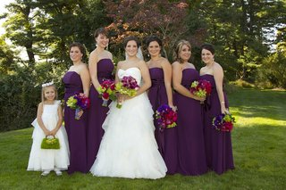 bride-with-flower-girl-and-bridesmaids-in-strapless-purple-gowns
