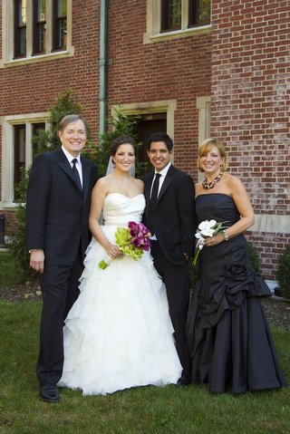 parents-of-the-bride-with-groom-and-daughter