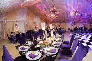 black-tables-surrounded-by-purple-reception-chairs