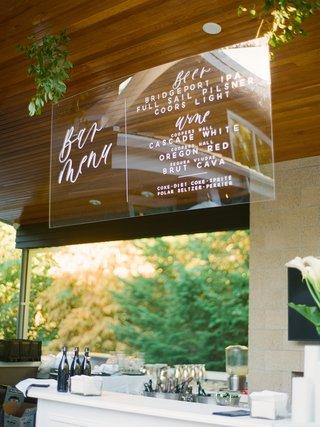 backyard-wedding-reception-with-suspended-acrylic-sheet-as-bar-menu