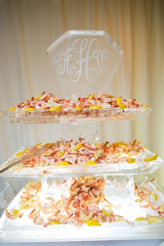 wedding-reception-cocktail-hour-ice-sculpture-with-monogram-seafood-display-shrimp-and-lemons-tiers