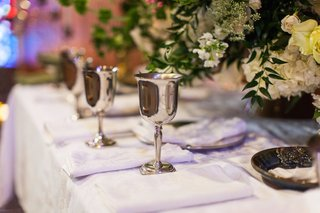goblets-and-white-napkins-on-church-altar