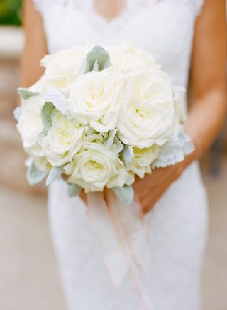 bride-holding-dusty-miller-and-white-florals