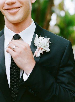 groom-wearing-polka-dot-tie-and-dusty-miller