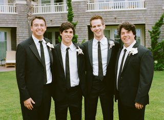 groom-with-brothers-of-bride-in-suits