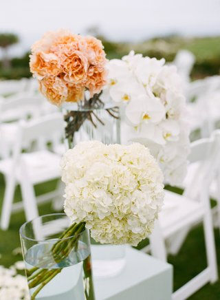 white-pedestals-topped-with-hydrangeas-and-orchids