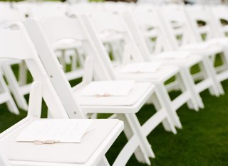 ribbon-tied-wedding-programs-on-each-chair