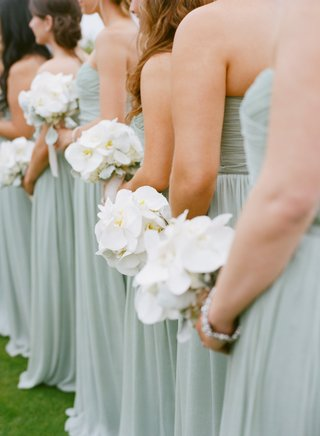 bridesmaids-in-blue-dresses-with-phalaenopsis-orchid