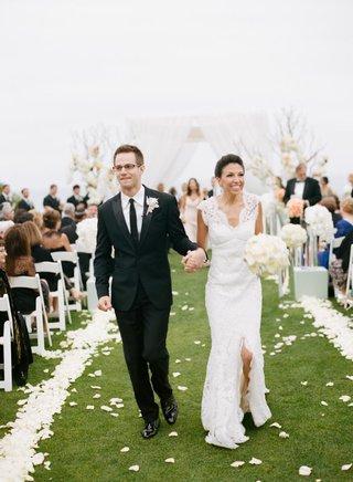 couple-exit-alfresco-ceremony-holding-hands