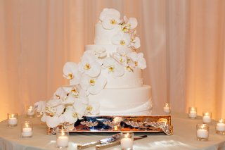 four-layer-cake-decorated-with-cascading-orchids