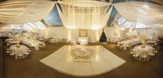 tented-wedding-reception-with-white-fabric-decor-piece-of-strings-of-beads-and-sequins