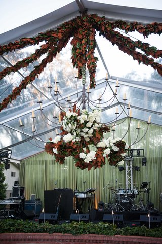 wedding-band-stage-at-at-home-wedding-reception-with-southern-magnolia-leaf-garland-decorations