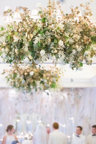 greenery-and-rocks-suspended-from-chandelier-all-white-decor-ballroom-ceremony-in-dallas