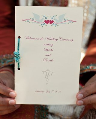 ceremony-booklet-tied-with-blue-glitter-ribbon