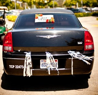 chrysler-300-with-silver-streamers-and-just-married-sign