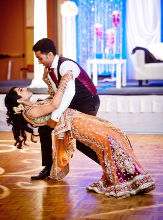 indian-bride-in-choli-and-groom-in-tux-on-dance-floor