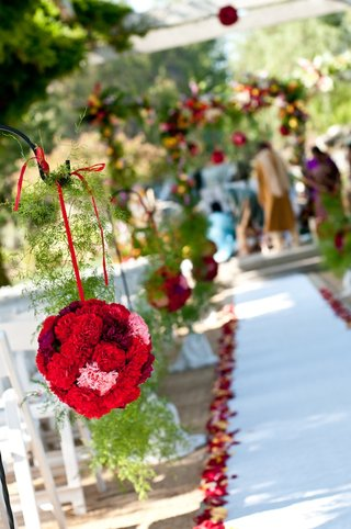 red-carnation-pomander-balls-line-aisle-runner