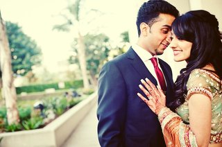 indian-woman-with-henna-and-man-in-suit-with-red-tie