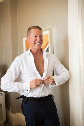 groom-buttoning-white-shirt-wedding-hotel-del-coronado-classic-stylish-look