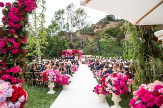 outdoor-jewish-wedding-ceremony-bright-pink-rose-magnolia-leaves-lavender-white-aisle-vineyard-chair
