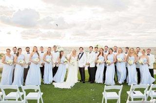 white-tuxedo-jacket-for-groom-and-groomsmen-light-blue-long-bridesmaid-dresses-island-destination