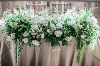 sweetheart-table-with-lots-of-greenery-with-white-flowers